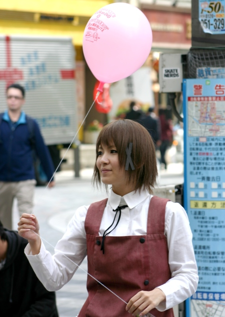 Akihabara cute girl handing out balloons
